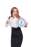 Glad businesswoman holding the clock. And showing thumbs up. isolated on white background Royalty Free Stock Images