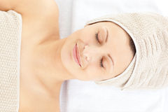 Glad caucasian woman resting on a massage table Royalty Free Stock Photography