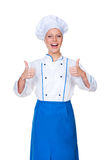 Glad chef showing thumbs up Royalty Free Stock Image