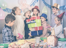 Glad children presenting gifts to girl  birthday Royalty Free Stock Image