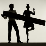 Glad couple carrying the empty board Stock Images
