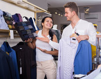 Glad couple chousing jacket, shirt and tie Royalty Free Stock Photo