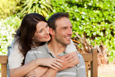 Glad couple hugging in the garden Royalty Free Stock Photos