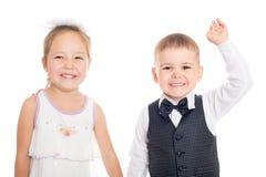 Glad europeisk pojke och asiatflicka Fotografering för Bildbyråer