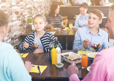 Glad family having lunch Royalty Free Stock Image