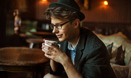Glad guy drinking a coffee Stock Image