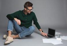 Content male student enjoying modern technology stock image