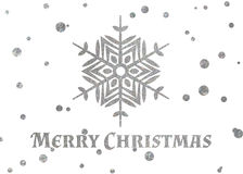 Glad jul för för silversnöflinga och inskrift Royaltyfri Foto