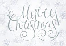 Glad jul för Handdrawn calligraphic inskrift Royaltyfria Bilder