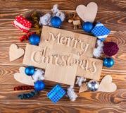 Glad jul för Wood inskrift på det wood brädet Arkivbild