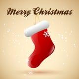 Glad jul med den hängande sockan Arkivfoton