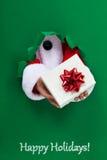 Glad jul med gåvor från jultomten royaltyfri fotografi