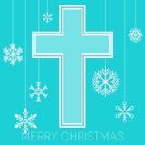 Glad jul med korset och snöflingor Arkivbild