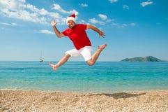 Glad jul och det nya året på stranden Arkivfoton