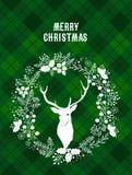 Glad jul och kort för lyckligt nytt år med en hjort Royaltyfri Foto