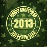 Glad jul och lyckligt nytt år 2013 över gräsplan Arkivbild