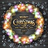 Glad jul och lyckligt nytt år 2017 Glödande julkrans som göras av ledde ljus på den gråa träbakgrunden Royaltyfri Fotografi