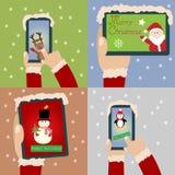 Glad jul och lyckligt nytt år med smartphonen och minnestavlan Royaltyfri Bild