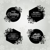 Glad jul och ram för lyckligt nytt år med snöflingor arkivfoto
