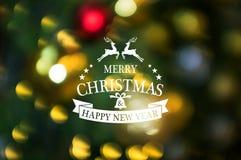 Glad jul och text för lyckligt nytt år med abstrakt suddighet chris royaltyfri bild