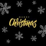 Glad jul! Räcka skriftlig bokstäver och julklottret på svart bakgrund Arkivbilder