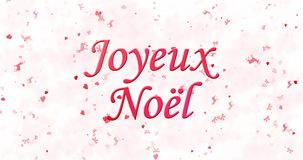 Glad jul smsar i franska Joyeux Noel som bildas från damm och vänd för att damma av horisontellt lager videofilmer