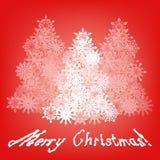 Glad jul som hälsar med tre träd Arkivfoto