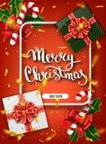 Glad jul som märker hälsningkortet för ferie Guld som skiner Garneringprydnad med med snöflingamodellen Guld- confett arkivfoto