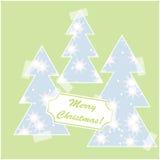 Glad julkort med snö och julträd Fotografering för Bildbyråer
