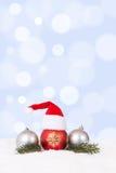 Glad julkorthattgarnering med granfilialen Fotografering för Bildbyråer