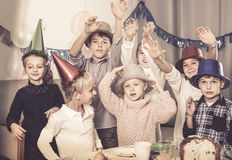 Glad kids having a good time at a birthday party Royalty Free Stock Photo