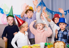 Glad kids having a good time at a birthday party Stock Photo