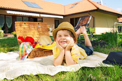 Glad little boy in the garden Stock Images