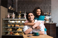 Glad loving couple dating in cafe Royalty Free Stock Images