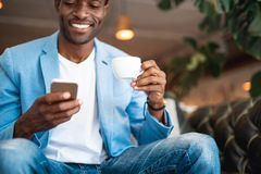 Positive man using gadget during rest Royalty Free Stock Photography