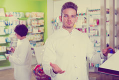 Glad man druggist in white coat Stock Images
