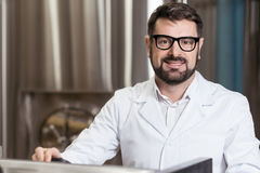 Glad man posing in brewery Stock Images