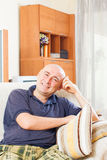 Glad man sitting on a couch royalty free stock photos