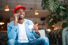 Glad man telling by phone Royalty Free Stock Images