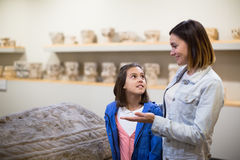 Glad mother and daughter looking at bas-reliefs Royalty Free Stock Image