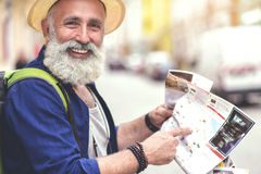 Glad old man searching for place of destination in city Royalty Free Stock Image