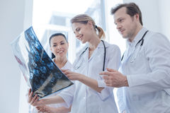 Glad oncologists discussing ct scan result in the clinic Stock Image