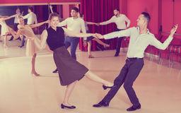Glad people dancing lindy hop in pairs Stock Image