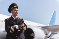 Happy smiling aviator near plane Royalty Free Stock Images