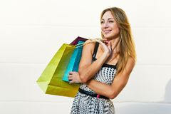 Glad pretty female shopper Stock Image