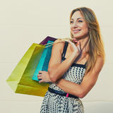 Glad pretty female shopper Royalty Free Stock Photo