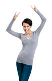 Glad pretty woman puts her hands up Stock Photos