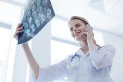 Glad radiologist analyzing brain x ray at the laboratory Royalty Free Stock Photos