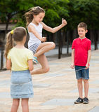 Glad small kids playing with jumping rope Stock Images