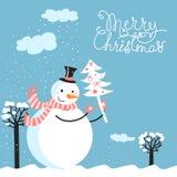 glad snowman för kortjul Fotografering för Bildbyråer